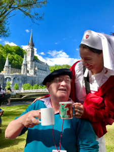 Alice Grogan pictured with a Malade in Lourdes at the Order of Malta's Piligrimage in 2017